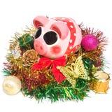 有圣诞节装饰的存钱罐 免版税库存图片