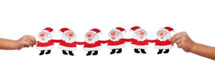 有圣诞节装饰的孩子手 免版税库存图片