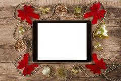 有圣诞节装饰的片剂个人计算机 免版税图库摄影