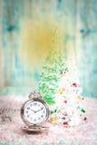 有圣诞节题材的怀表 免版税库存照片