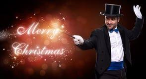 有圣诞节魔术的魔术师 免版税库存图片
