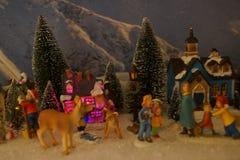 有圣诞装饰的小微型村庄 库存图片