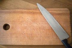 有在委员会的一把刀子 免版税库存照片