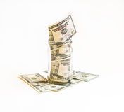 有在它投资的美元的玻璃瓶子在钞票 免版税库存照片