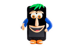 有在彩色塑泥做的一张愉快的面孔的一个智能手机 免版税库存照片