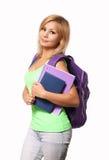 有在白色和书的学生女孩隔绝的背包 免版税库存照片