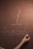 有在白色白垩1日黑板写的9月的,在黑板的手文字 免版税库存照片