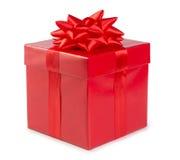 有在白色背景隔绝的丝带的红色礼物盒 库存照片