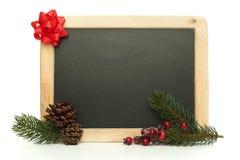 有在白色背景隔绝的圣诞节装饰的空白的黑板 免版税图库摄影