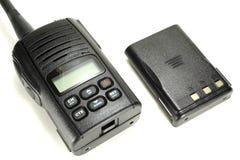 有在白色背景隔绝的备用电池的便携式的携带无线电话 图库摄影