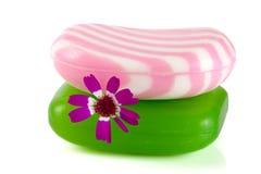 有在白色背景隔绝的花的两块多彩多姿的镶边肥皂 库存照片