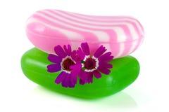 有在白色背景隔绝的花的两块多彩多姿的镶边肥皂 免版税库存照片