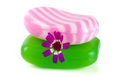 有在白色背景隔绝的花的两块多彩多姿的镶边肥皂 库存图片