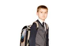 有在白色背景隔绝的袋子的男小学生 免版税图库摄影