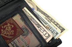 有在白色背景隔绝的钞票的钱包 库存图片