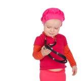 有在白色背景隔绝的phonendoscope的女婴 库存图片