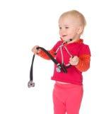 有在白色背景隔绝的phonendoscope的女婴 免版税库存照片