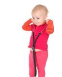 有在白色背景隔绝的phonendoscope的女婴 免版税图库摄影