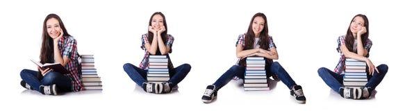 有在白色隔绝的书的年轻学生 免版税图库摄影