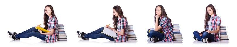 有在白色隔绝的书的年轻学生 免版税库存图片
