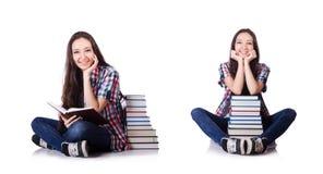 有在白色隔绝的书的年轻学生 免版税库存照片