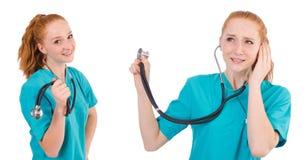 有在白色隔绝的听诊器的年轻医疗实习生 库存照片