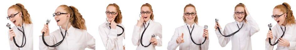 有在白色隔绝的听诊器的相当女性医生 免版税库存照片