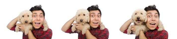 有在白色隔绝的狗的年轻人 免版税库存图片
