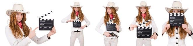 有在白色隔绝的电影委员会的年轻女牛仔 图库摄影