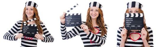 有在白色隔绝的电影委员会的年轻妇女囚犯 免版税图库摄影