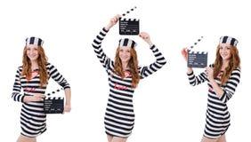 有在白色隔绝的电影委员会的年轻妇女囚犯 免版税库存照片