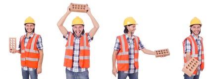 有在白色隔绝的砖的年轻瓦工 免版税库存图片