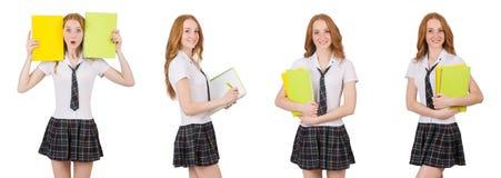 有在白色隔绝的课本的年轻学生女性 库存图片