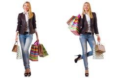 有在白色隔绝的购物带来的美女 免版税库存照片