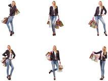 有在白色隔绝的购物带来的美女 库存图片