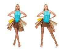 有在白色隔绝的购物袋的妇女 免版税库存图片