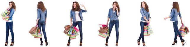 有在白色隔绝的购物袋的少妇 免版税库存图片