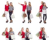 有在白色隔绝的购物袋的朋友 免版税图库摄影