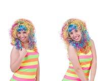 有在白色隔绝的五颜六色的假发的妇女 免版税库存图片