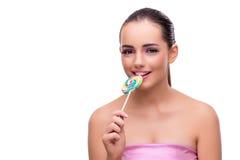 有在白色隔绝的五颜六色的棒棒糖的妇女 库存图片