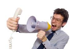 有在白色隔绝的扩音器的年轻雇员 免版税库存图片