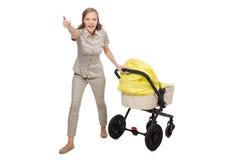 有在白色隔绝的摇篮车的妇女 免版税库存图片