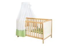 有在白色隔绝的机盖的婴儿床,与道路 库存照片