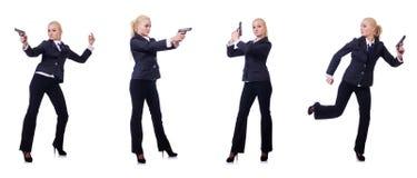 有在白色隔绝的枪的妇女 免版税库存图片
