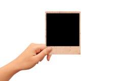 有在白色隔绝的照片卡片的手 库存图片