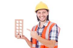有在白色隔绝的砖的年轻瓦工 库存照片