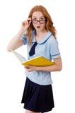 有在白色隔绝的笔记本的年轻学生 库存照片