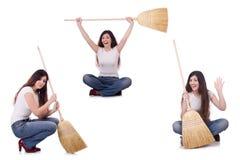 有在白色隔绝的笤帚的妇女 免版税库存照片