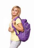 有在白色隔绝的背包的学生女孩 回到学校 库存照片