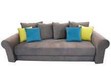 有在白色隔绝的色的坐垫的灰色沙发家具 免版税库存照片